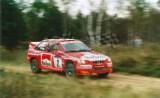 09. Janusz Kulig i Jarosław Baran - Ford Escort WRC.